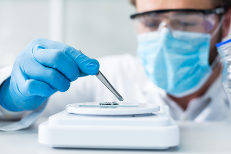 Laboratory analysis. Selective focus of tweezers being used for taking samples for laboratory analysis