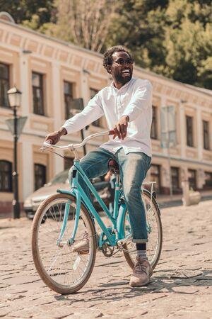 Man enjoying cycling and smiling stock photo