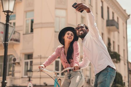 Funny selfies outdoors together stock photo