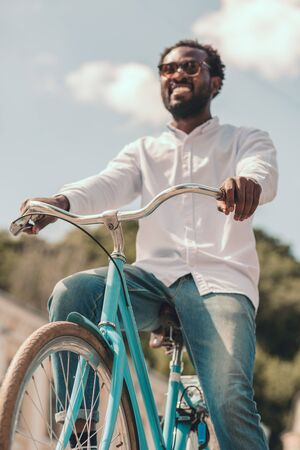 New bike of happy young man stock photo