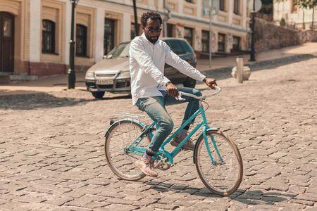 Careful man turning on the bike stock photo
