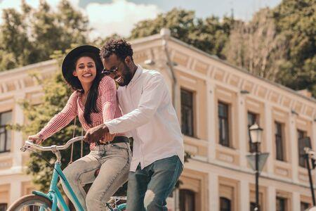 Couple with bike looking happy stock photo