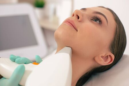 Smiling woman with laser hair removal under her chin