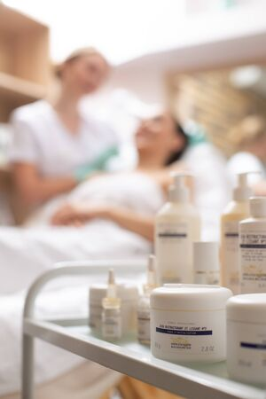 Selective focus on cosmetic creams in white bottles Stock fotó