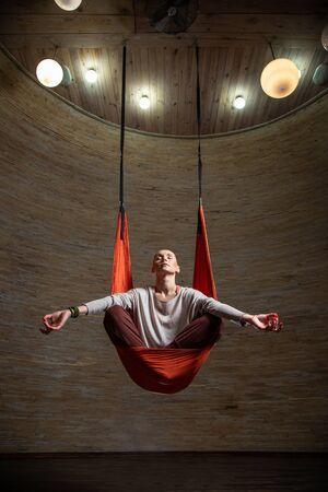 Full length of aerial yoga in hammock