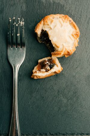 Vertical photo of metal fork and mince pie near