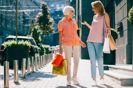 Stylish ladies after shopping looking happy