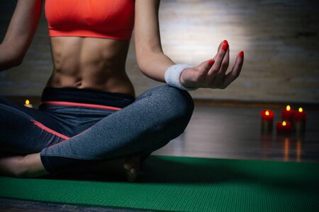 Close up of mediation pose of young woman