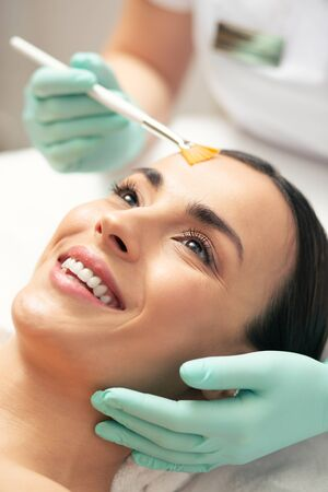 Excited woman revealing her teeth while smiling at cosmetic procedure