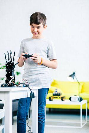 Positive smart boy testing his engineering creation Stock Photo - 135458403