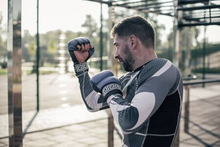 Bearded boxer performing the stances and looking concentrated