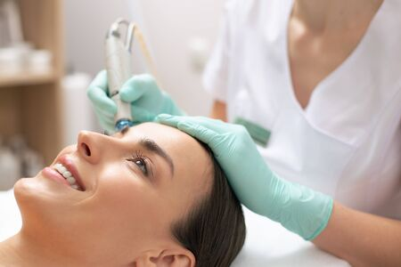 Close up of medical procedure of cleaning face Banco de Imagens