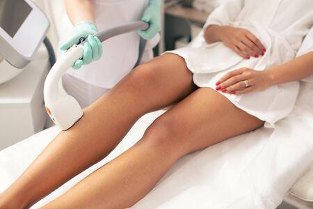 Legs of woman and laser hair removal procedure Zdjęcie Seryjne