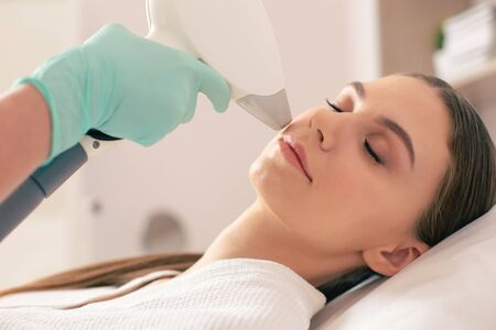 Close up of laser hair removal on the face