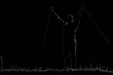MBlack image of a pleasant motivated man holding Nordic walking sticks while expressing his hidden emotions