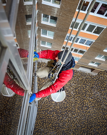 window washer cleans the residential building