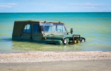 submerged: car car submerged in the sea Stock Photo