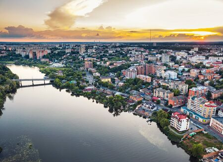 Panoramic european provincial country town or city with river, drone air photo Vinnitsa, Ukraine sunset