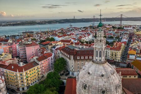 dome of the church and rooftops of Lisbon Lapa basilica, aerial view