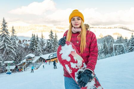 beautiful girl smile alone with snowboard, winter sport activity, forest snow outdoors lifestyle
