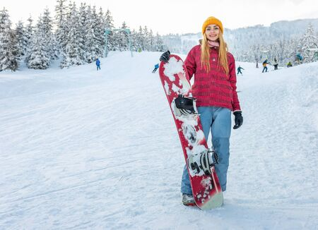 girl or sport woman snowboarder smile stay with snowboard winter outdoor, activity lifestyle