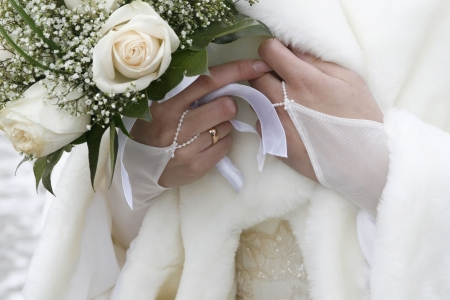 Wedding bouquet in a hand of the bride photo