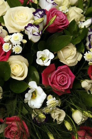 live coral: White, yellow, red roses, irises and chrysanthemums in a bouquet  Stock Photo