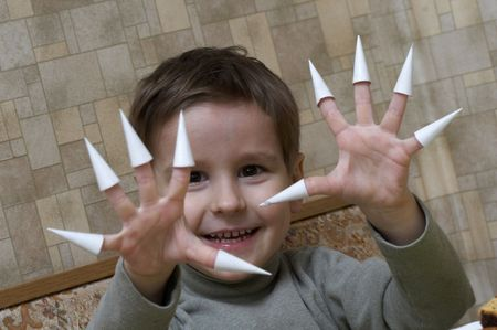 The child with pleasure represents animal claws in game Stock Photo - 2471318