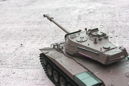 green military miniature: Model of tank.