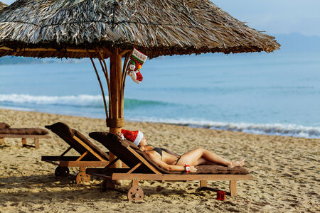 beach happy new year: Happy new year girl in bikini on the beach laying on sunbed with seaview