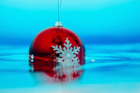 new year tree decoration in the water, christmas decoration in blue water Stock Photo