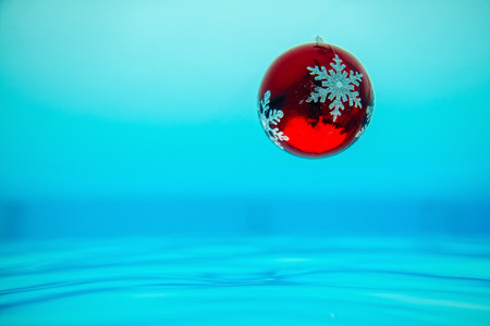 new year tree decoration in the water, christmas decoration in blue water in tropics