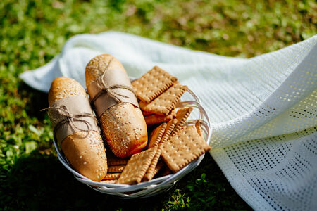 country style: bakery and cookies on the plate with green grass background in country style