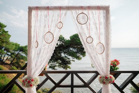 destination wedding: destination wedding arch with sea view