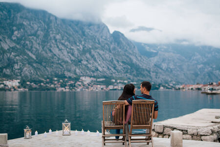 couple on the beach with candles in romantic place with mountain and bay view in Montenegro photo