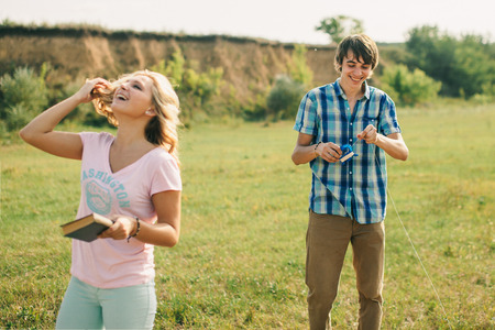 love story teenage couple smiling outdoors photo