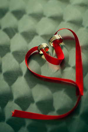heart shape red band with engagement rings photo