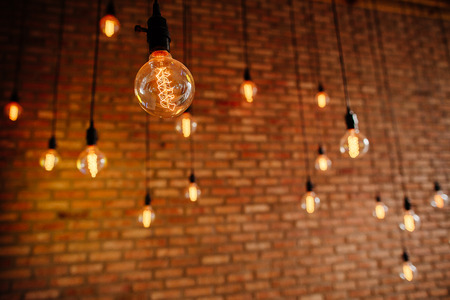 light bulb Edison  filament retro vintage decore on brick wall background. Lighting decoration