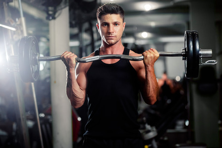 handsome athletic man workout in gym with weights