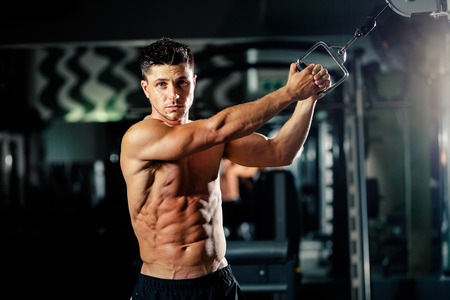 push: handsome athletic man push up workout in gym Stock Photo