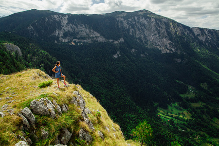 fascinating: woman stand at the end of earth in fascinating landscape in Montenegro