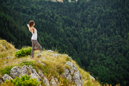 fascinating: woman yoga relax at the end of earth in fascinating landscape in Montenegro