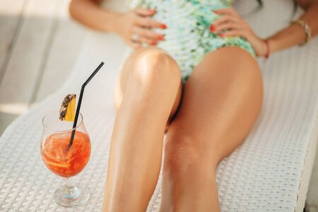 long legged: long legged girl with tropical cocktail Stock Photo
