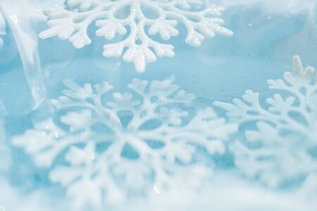 melts: snowflake melts in water macro cool abstract background Stock Photo