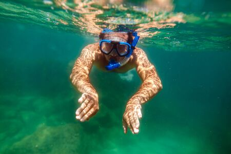 sea  scuba diving: snorkling man swim underwater in turquoise sea