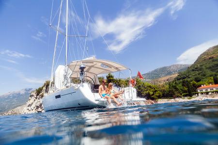couple yacht honeymoon sailing luxury cruise. View from the water Stock Photo