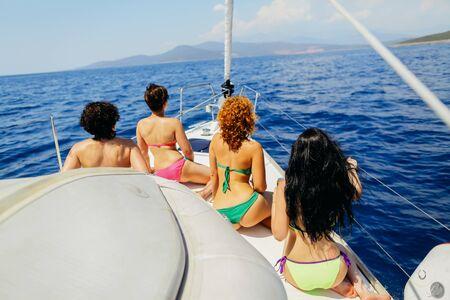 yachting: sexy women yachting sea in bikini back view