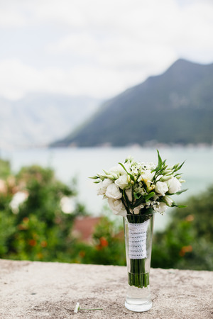 white flowers bouquet outdoors with mountains background