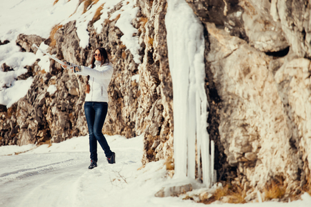 january 1: woman play with ice and snow in mountains. Pisturesque snowy mountains in Montenegro, Durmitor