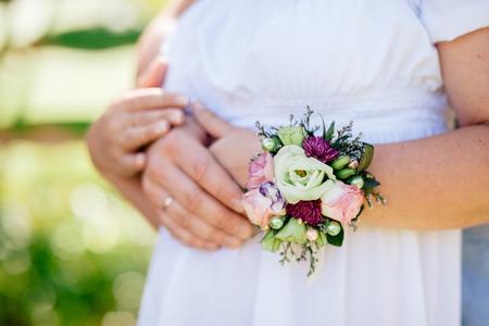 engaged couple hug together. Close up shot of hands